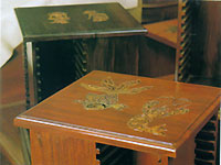Carved wooden tables with inset cap