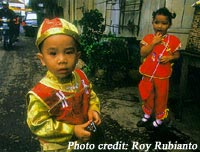 Children celebrate their ethnic heritage by wearing traditional Chinese dress